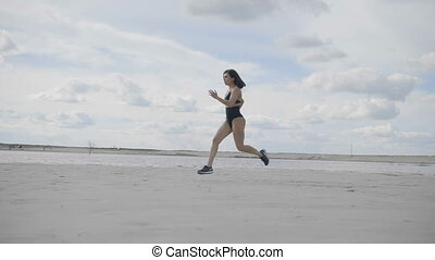 Woman is running on the beach