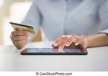 Woman is shopping online with tablet pc