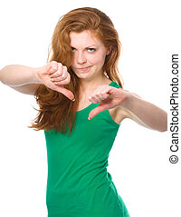 Woman is showing thumb down gesture