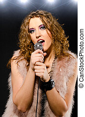 singing glam rock song - woman is singing glam rock song...