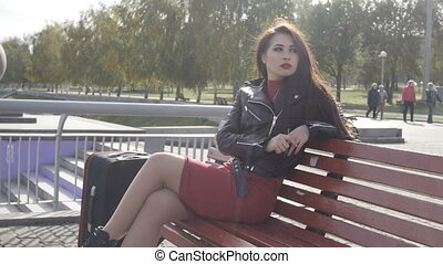 Woman is sitting on bench
