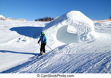 woman is skiing on a sunny day