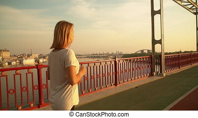 woman is starting her morning jog - female runner begins to...