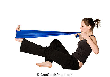 Woman is stretching her leg with a Resistance Band - Young...