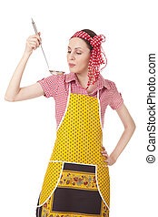Woman is tasting a dish - Woman with ladle is tasting a...