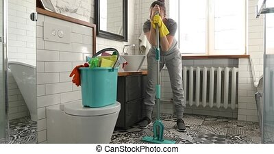Woman is tired to cleaning tile in toilet
