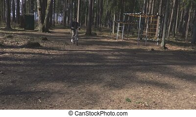 Woman is trying to ride a bike