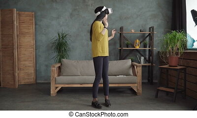 Woman is using a vr head-mounted display