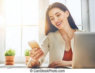 Woman is using phone.