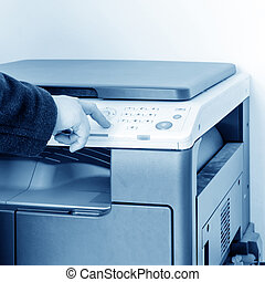 Woman is using the copier