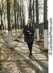 Woman is walking in the park