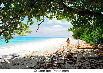woman is walking on the beach for relaxation