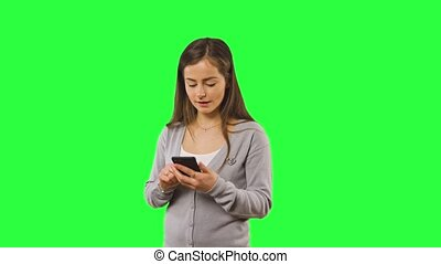 Woman isolated on green screen with phone