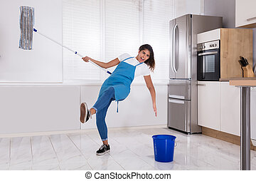 Janitor Slipping While Mopping Floor