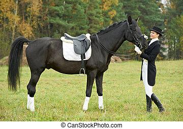 woman jockey in uniform with horse - jockey woman in uniform...