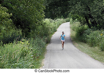 Woman jogging along a pathway