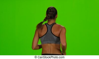 Woman jogging. Back view. Green screen