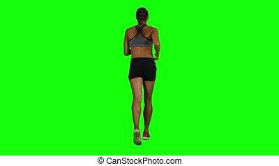 Woman jogging. Back view. Green screen - Young and beautiful...