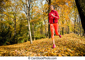 Woman jogging in nature - Young woman jogging in beautiful...