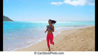 Woman jogging in the beach 4k - Woman jogging in the beach...