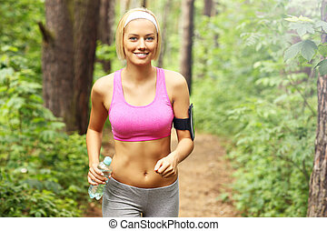 Woman jogging in the forest