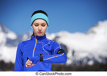 Woman jogging in winter nature - Young sportswoman jogging...