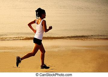 woman jogging on beach