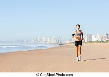 woman jogging on beach