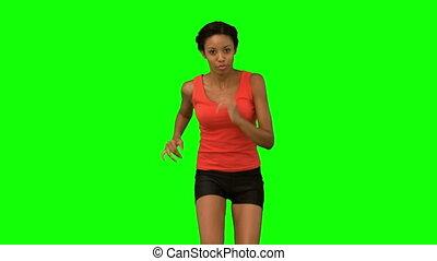 Woman jogging on green screen