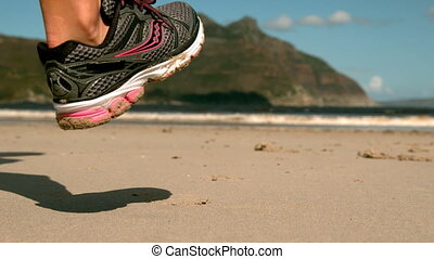 Woman jogging on the sand