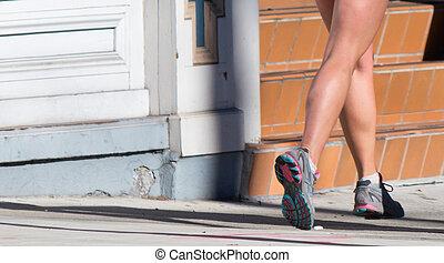 Woman jogging on the sidewalk