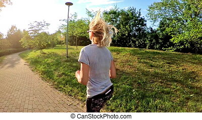 Woman jogging outdoor - SLOW MOTION fit blonde woman running...