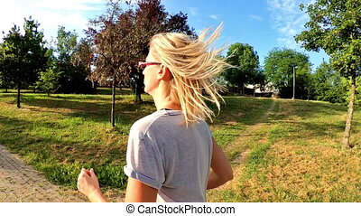 Woman jogging outdoor - SLOW MOTION of healthy lifestyle...