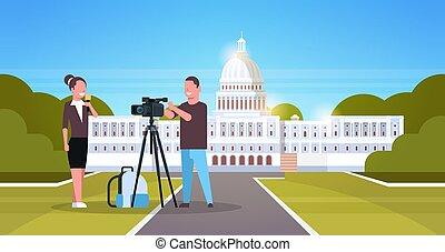 woman journalist with reporter man presenting live news operator using video camera on tripod recording correspondent movie making concept horizontal senate white house washington ds background