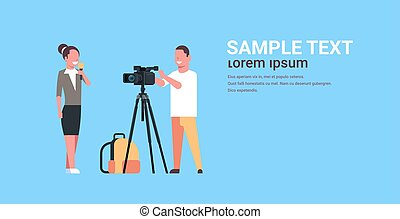 woman journalist with reporter man presenting live news operator using video camera on tripod recording correspondent with microphone movie making concept horizontal copy space