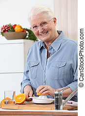 Woman juicing an orange