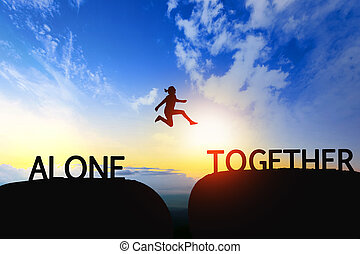 Woman jump through the gap between Alone to Together on sunset.