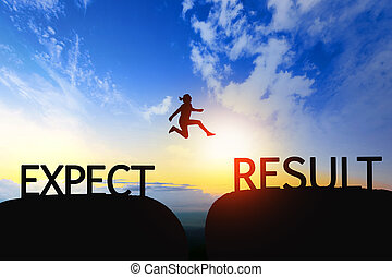 Woman jump through the gap between Expect to Result on sunset.
