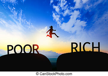 Woman jump through the gap between POOR to RICH on sunset.