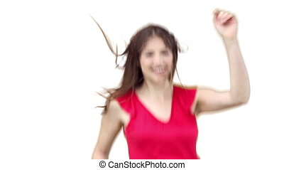Woman jumping energetically against a white background