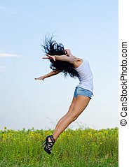 Woman jumping for joy - Woman in stilettoes jumping for joy...