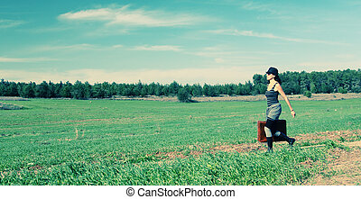 Woman jumping in the field