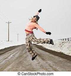 Woman jumping joyfully.