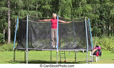 Woman jumping on a trampoline