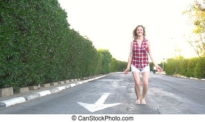 Woman jumping on the road - Happy woman jumping on the road...