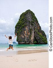 woman jumping on  tropical Beach