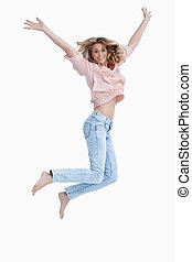 Woman jumping up with her arms raised
