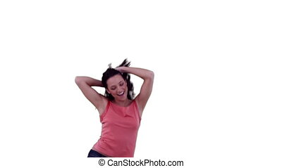 Woman jumping while feeling her hair