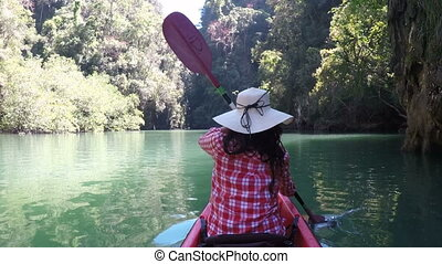 Woman Kayaking In Beautiful Lagoon Action Camera Back Rear Point Of View Of Girl Paddling On Kayak Boat