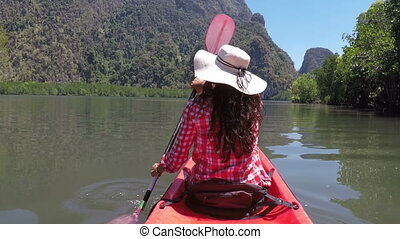 Woman Kayaking In Beautiful Lagoon Action Camera POV Of Girl...